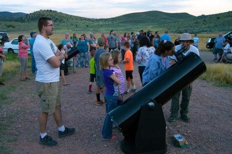Andrew using SUSF's telescope to view Jupiter