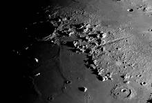 close up of lunar surface and craters through a ground telescope
