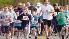 kids and adults running in a race