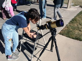 Child at Solar telescope